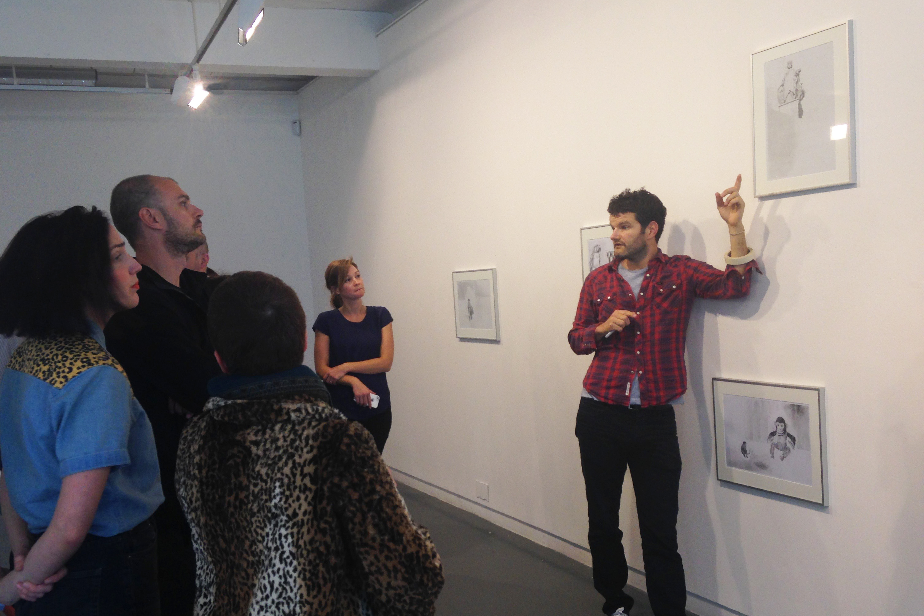 Danny Holcroft discusses his work with audience members at 'Lost in Translation' 12 to 18 June 2016 An installation of drawings, paintings, sculptures, performance and video by Danny Holcroft at The Project Room, Trongate 103, Glasgow © Cultural Documents
