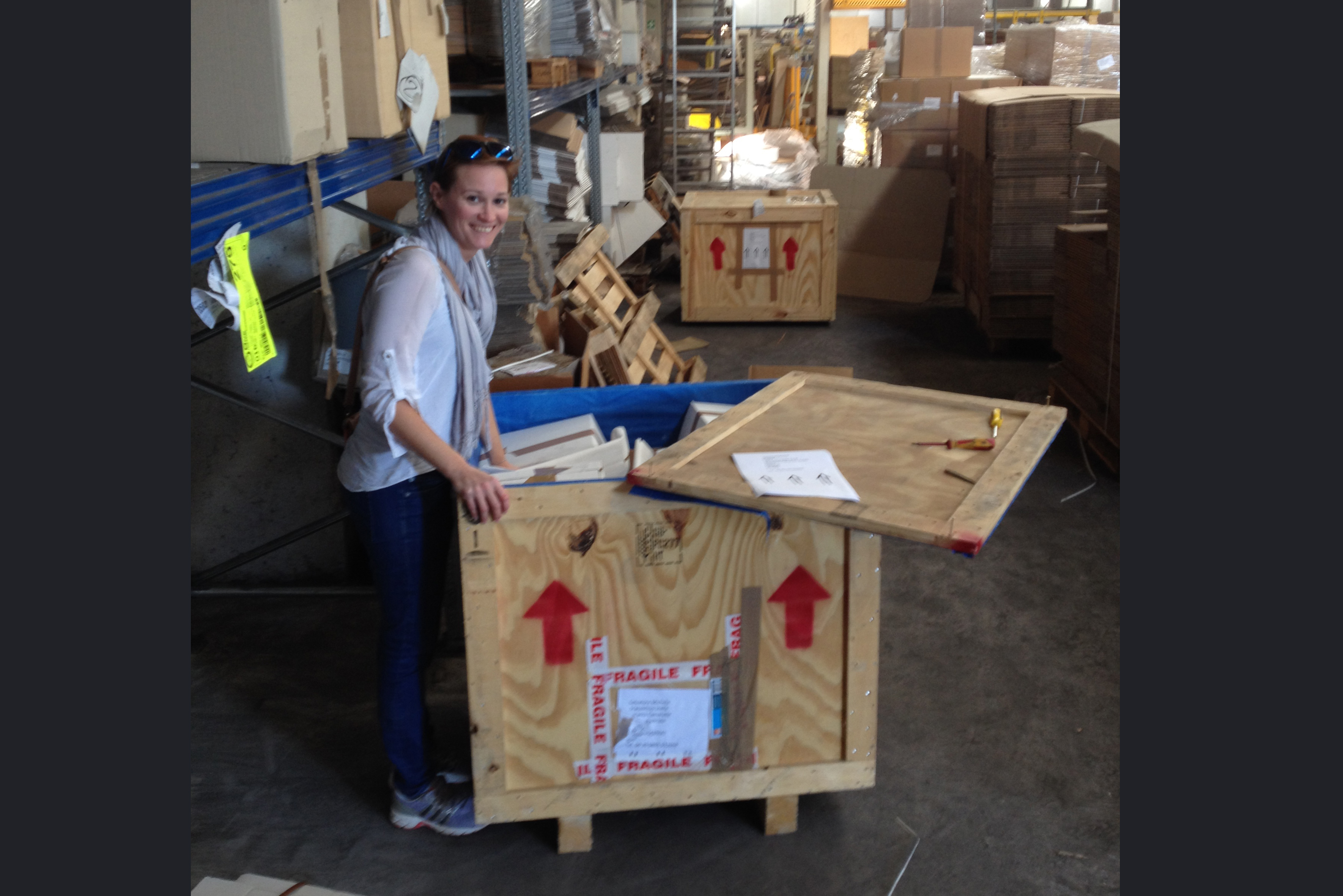 Artist Lauren Wells unloading her crates of art works and equipment after delivery from Scotland at the Scatolificio Stella depot in Italy © Cultural Documents