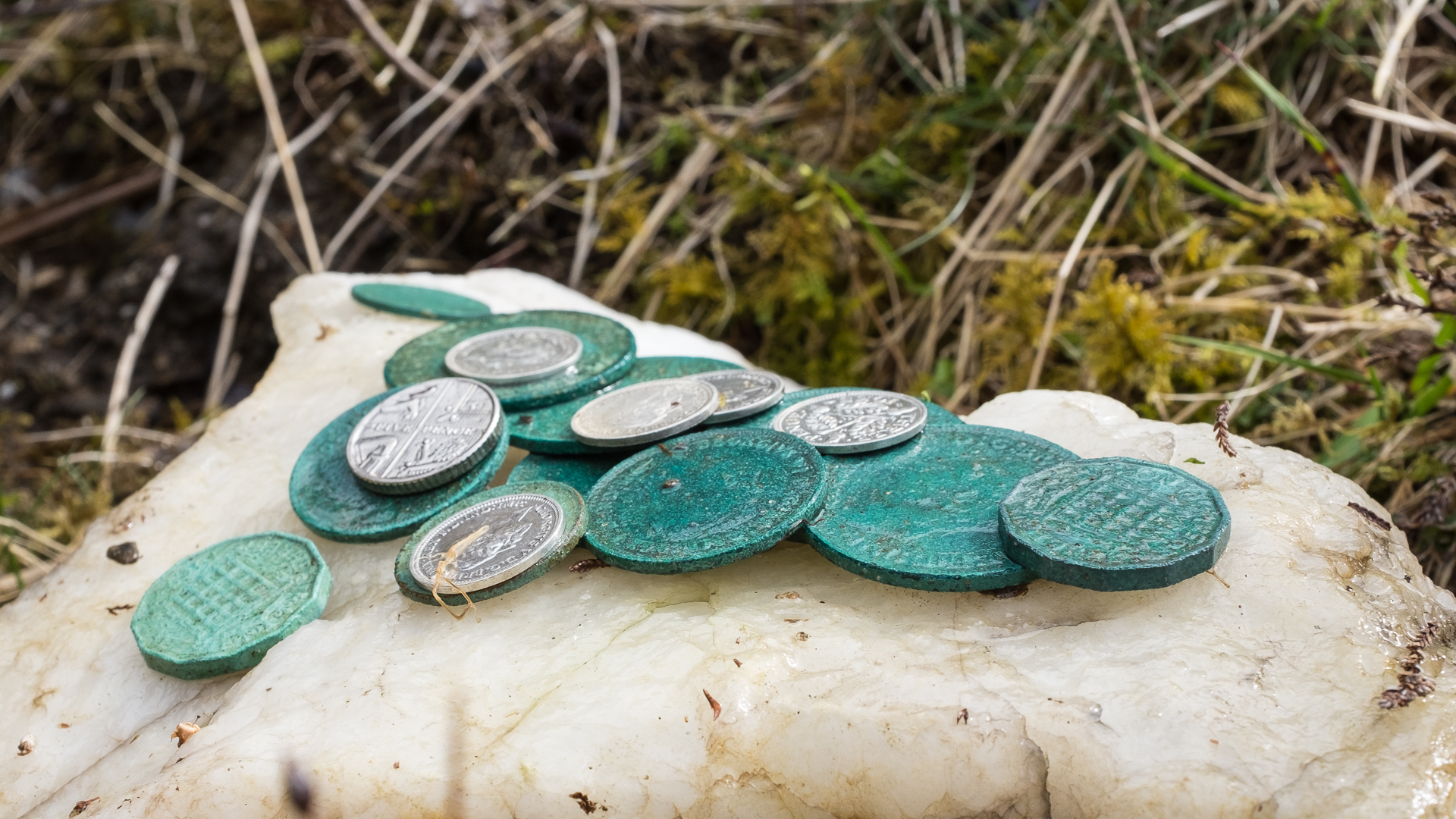 Shiehallion Well. Image showing antique coins temporarily removed from the Schiehallion for The Well at the World's End. 2016 © Alexander and Susan Maris